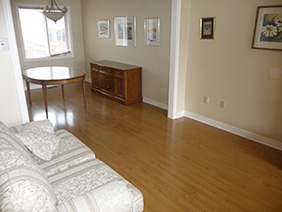Light coloured laminate flooring in Milton,Ontario.