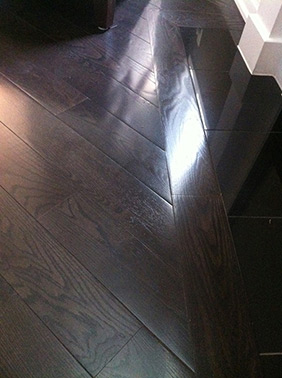 Dark hardwood flooring installed by RE Flooring Ltd.